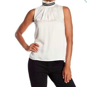 Nanette Lepore Ruffle Mock Neck sleeveless blouse